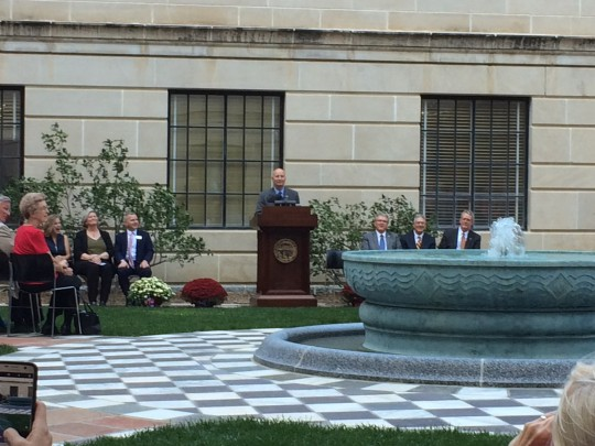 Governor Ricketts starts the fountain during the dedication ceremony.
