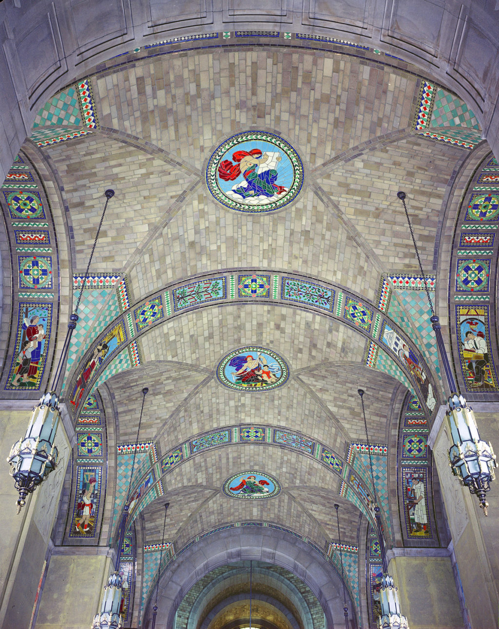 The foyer ceiling with mosaics of the activities of society.